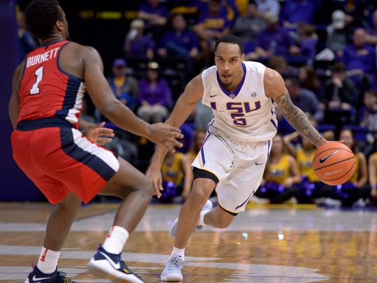 LSU guard Daryl Edwards (5) drives past Mississippi guard Deandre Burnett (1) during a game last season.