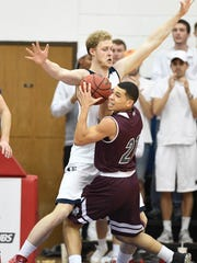 USI's Davis Carter guards Bellarmine's Jarek Coles as the University of Southern Indiana plays Bellarmine University at the PAC Arena Monday, January 16, 2016.