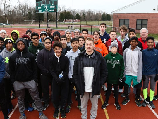 Head track coach Sam Tooley with his track team at