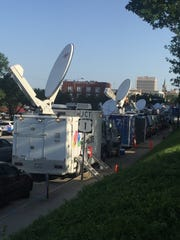 Media trucks line up in Columbia for the Confederate flag's removal from the South Carolina Statehouse grounds.