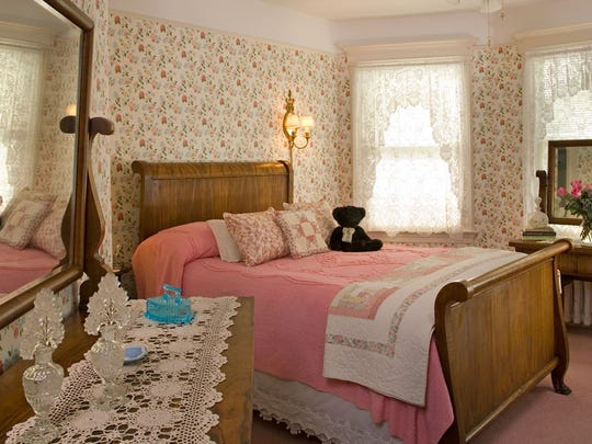 All five of the Main Street Manor guest rooms are enhanced by period furnishings among the queen beds and private baths.