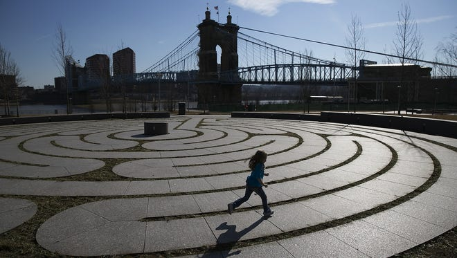 A young girl runs the labyrinth at Smale Riverfront Park.