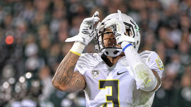Sep 12, 2015; East Lansing, MI, USA; Oregon Ducks quarterback Vernon Adams Jr. (3) celebrates a run for a touchdown during the 2nd half of a game at Spartan Stadium. MSU won 31-28. Mandatory Credit: Mike Carter-USA TODAY Sports