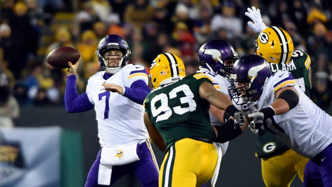 Minnesota Vikings quarterback Case Keenum (7) gets a pass of under pressure from Green Bay Packers linebacker Reggie Gilbert (93) in the first quarter on Dec. 23, 2017, at Lambeau Field.