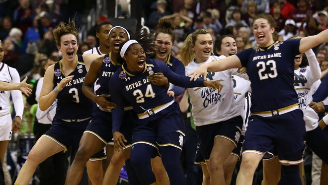 Notre Dame's Arike Ogunbowale celebrates with teammates after making the game-winning three-pointer against Mississippi State in the women's college basketball national championship at Nationwide Arena in Columbus, Ohio.