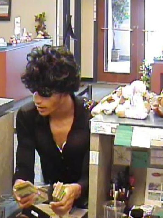 This man was dressed as a female when he robbed a West Manchester Township bank Thursday.