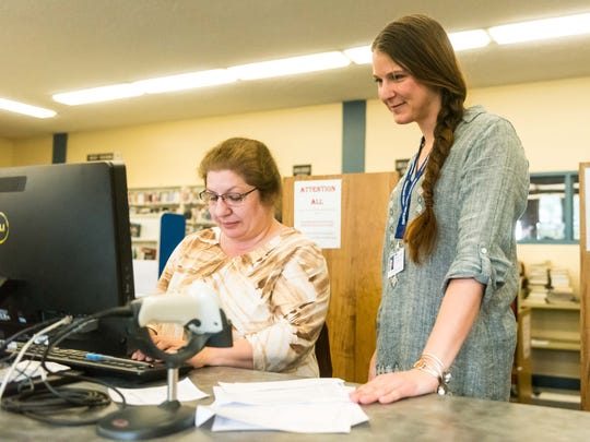 Cumberland County Library Director Susanne Sacchetti works with an assistant at the Cumberland County Library on Monday, April 24.