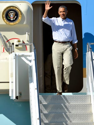 President Barack Obama waves after arriving aboard Air Force One at Palm Springs International airport, on Saturday.
