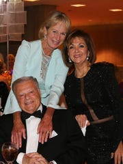 Shellie Reade, left, and Angie Gerber, with Harold