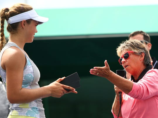 Rosie Casals (right) presents Ellie Douglas with her finalist trophy in 2016, after the Easter Bowl championship match at the Indian Wells Tennis Garden. Casals has been a supporter of junior tennis since her playing days.
