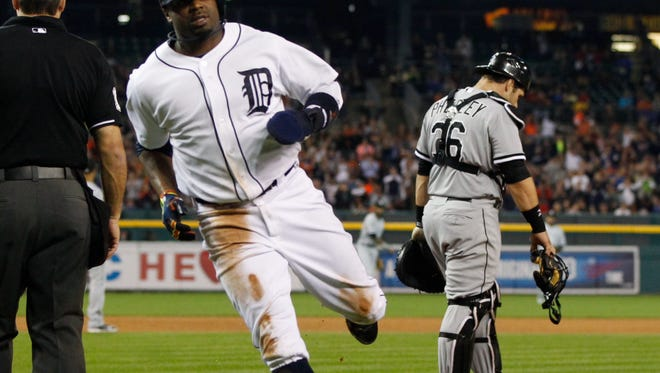 Detroit Tigers Rajai Davis scores first run of game on throwing error by Chicago White Sox catcher Josh Phegley, back right, in the fifth inning in Detroit on Tuesday, September 23, 2014.