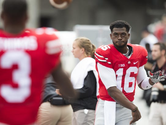 Ohio State quarterback J.T. Barrett loosens up on the