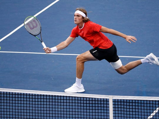 Stefanos Tsitsipas, of Greece, returns the ball to Nick Kyrgios, of Australia, during a semifinal at the Citi Open tennis tournament, Saturday, Aug. 3, 2019, in Washington. (AP Photo/Patrick Semansky)