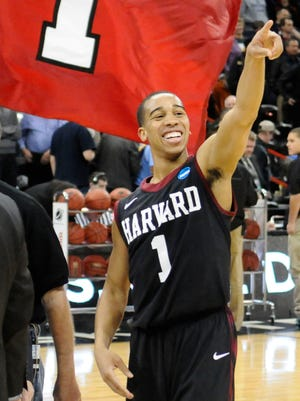 Harvard Crimson guard Siyani Chambers (1) celebrates after a men's college basketball game during the second round of the 2014 NCAA Tournament against the Cincinnati Bearcats at Veterans Memorial Arena.