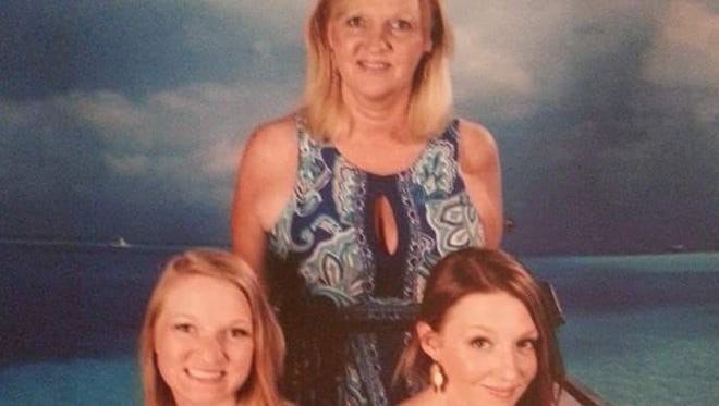 Kathleen Lent, standing, with daughters, Corinne, left, and Shannon, ended up dropping BlueCross BlueShield of Tennessee's network E.