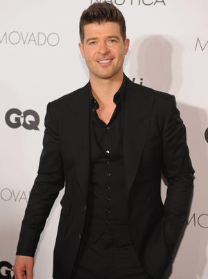 Robin Thicke walks the red carpet at the 2013 GQ Gentlemen's Ball on Oct. 23 in NYC.