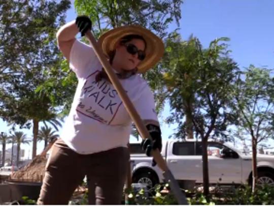 A volunteer helps construct the Las Vegas Community
