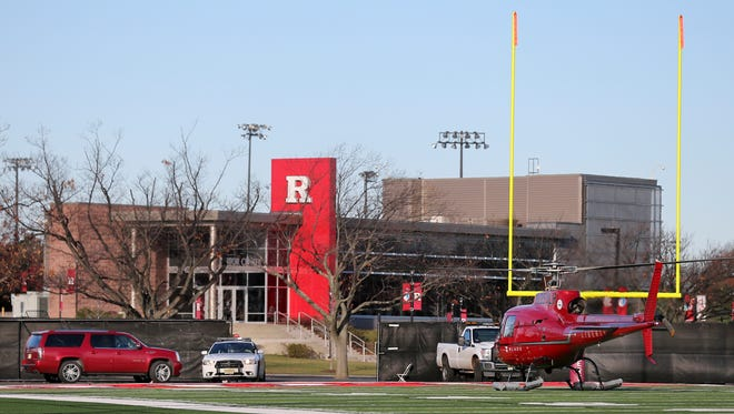 Rutgers football head coach Kyle Flood arrives by helicopter at the Rutgers practice after being fired.
