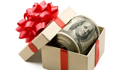 Surprise someone by tucking cash into other gifts.