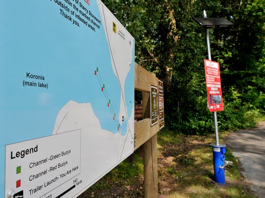 Signs posted at the public access to Lake Koronis off Minnesota Highway 55 near Paynesville inform boaters of the Koronis Lake Association's efforts to stop the spread of the aquatic invasive starry stonewort, which was confirmed in the lake Aug. 28, 2015.