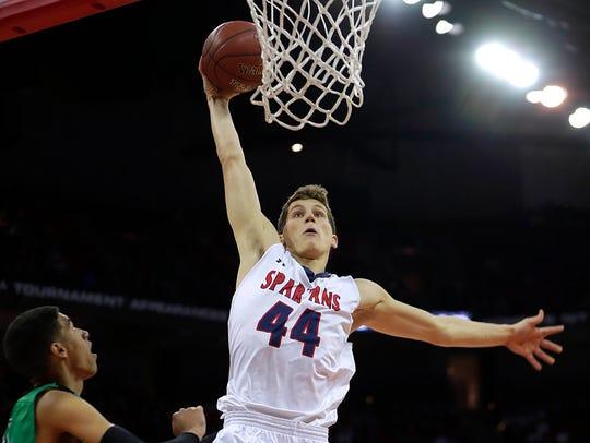 Brookfield East's Patrick Cartier dunks the ball.