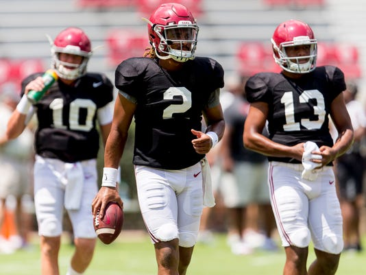 Alabama quarterback Jalen Hurts (2) leads the way to the next drill during Alabama's fall camp football practice, Saturday, Aug. 19, 2017, at Bryant-Denny Stadium in Tuscaloosa, Ala. The individual drills preceded the Tide's second scrimmage. Alsop pictured are Alabama quarterback Mac Jones (10) and Alabama quarterback Tua Tagovailoa (13). (Vasha Hunt/Alabama Media Group via AP)