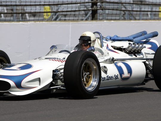 Mario Andretti, 1968 Indianapolis 500 champion, sped down the main straightaway in the 1967 pole-sitting car as he joined his son Michael, and grandson Marco for a ceremonial lap to open practice for the 90th running of the Indianapolis 500 at the Indianapolis Motor Speedway, Sunday, May 7, 2006 in Indianapolis.  (AP Photo/Michael Conroy)
