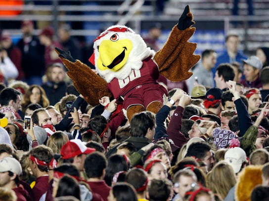 Boston College students celebrate on the field after the team defeated Florida State 35-3 during an NCAA college football game in Boston, Friday, Oct. 27, 2017. (AP Photo/Michael Dwyer)