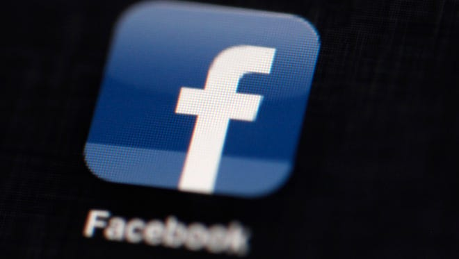 In this 2012 file photo, the Facebook logo is displayed on an iPad in Philadelphia. New research suggests that Facebook posts with a positive or negative tone prompt subsequent posts with similar sentiments.