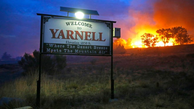 A wildfire burns homes in Yarnell, Ariz., on June 30.