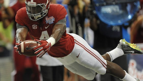 Alabama running back T.J. Yeldon dives for a first-half