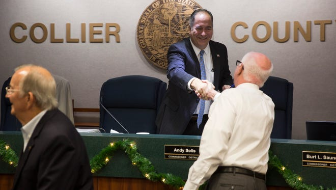 Newly elected District 2 Commissioner Andy Solis greets the public before the start of a Board of County Commissioners meeting Tuesday, Dec. 13, 2016, in Naples.