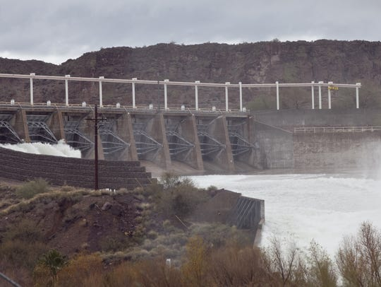 Water is released from Stewart Mountain Dam into the Salt River, part of the water delivery system managed by Salt River Project.