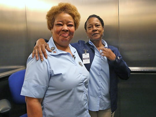 Denise Cummings, left, a service elevator operator