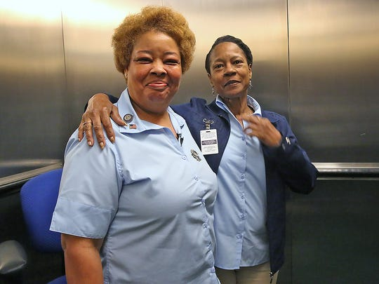 Denise Cummings, left, a service elevator operator at the City-County Building since 1981, poses with Deborah Bishop, the operator of the elevator to the observation deck.