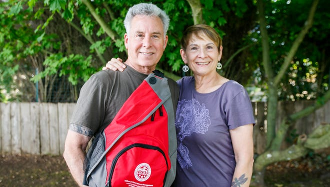 Carlos and Vickie Simpson hold their 72-hour disaster preparedness kit, which they won in the Statesman Journal's monthly drawing by taking the online Think Big survey. The kit is filled with water pouches, light sticks, food staples and a first-aid kit, and as provided by the state's Office of Emergency Management.