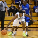 Richard Gaines of Eastern Florida chases down a loose ball in front of St. Petersburg player Dondre Duffus during their game Tuesday evening.