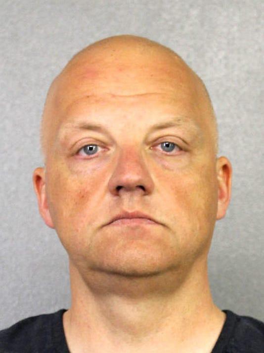 636233806010699118-IMG-AP-Volkswagen-Arrest-1-.jpg