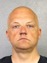 This photo provided by the Broward County Sheriff's Office shows Oliver Schmidt under arrest on Jan. 7, 2017. Schmidt, the general manager of the engineering and environmental office for Volkswagen America, has pleaded guilty in connection with the company's emissions-cheating scandal.