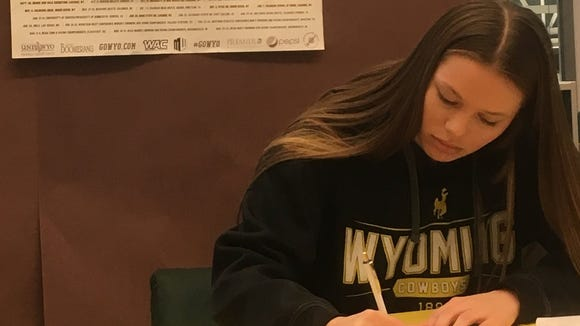 Klahowya's Kira Crane signs her National Letter of Intent with Wyoming on Wednesday.