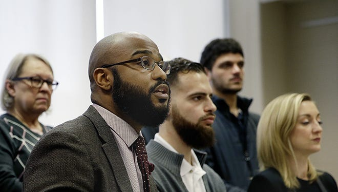 Sitting from left are Dominic Dorsey, a community activist; Hassan Jamal, a board member of Students for Justice in Palestine and a student at Indiana University-Purdue University Indianapolis, and Erin Polley, Indiana coordinator for the American Friends Service Committee. They held a news conference at IUPUI on Friday, April 8, 2016, in support of a female Muslim student who has faced harassment on campus.
