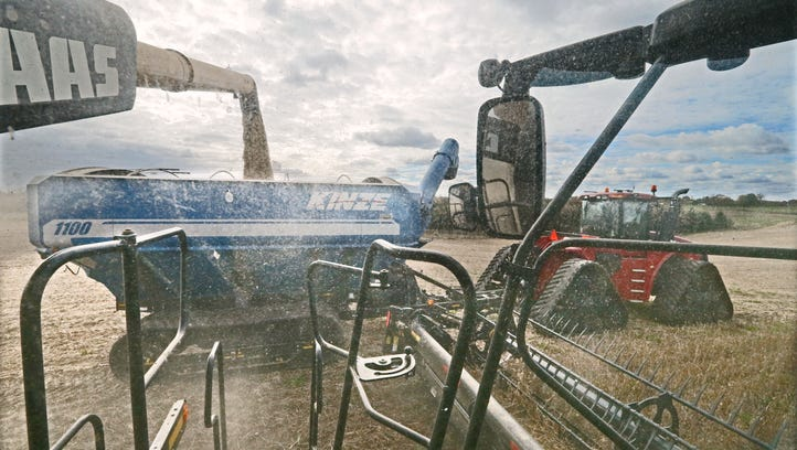 Charles Hammer unloads harvested soybeans as he continues