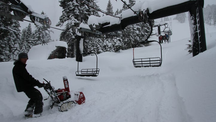 A worker at Homewood Mountain Resort clears snow from