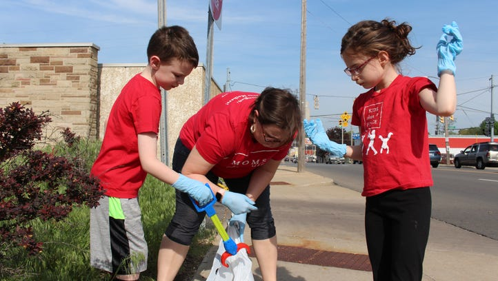 Volunteers clean up downtown Mansfield as part of Operation Clean Sweep