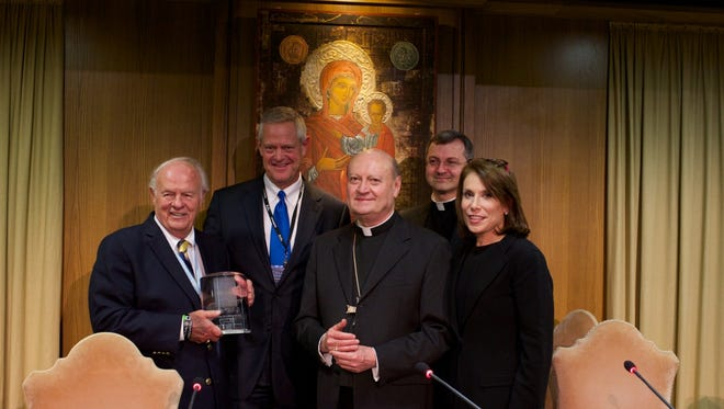 Denny Sanford and Kelby Krabbenhoft accept the Pontifical Key Innovation Award in Vatican City April 28.