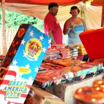 Ki Miles, left, and Charlene Miles shop for fireworks at a stand on Oak Grove Road and Old Highway 11.