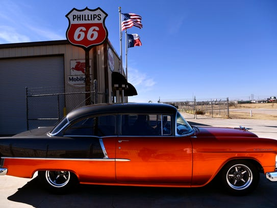 Jack Young pulls forward in a 1955 Chevrolet Bel Air 210 owned by Maxey Chittum, at Young's shop in Abilene Wednesday.