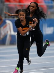 Iowa's Briana Guillory hands off the baton to Alexis Hernandez in the women's 4x400 meter relay Saturday, April 29, 2017, at Drake Relays in Des Moines.