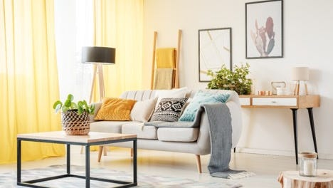 A pop of color in an otherwise monochromatic scheme can give your interior a glow-up. It's a trend you'll see a lot of this season.