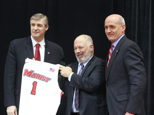 From left, Marist men's basketball head coach, John Dunne, college president, David Yellen and director of athletics, Tim Murray during Thursday's press conference at Marist College on April 5, 2018.